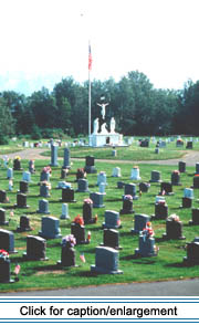Madawaska's Saint Thomas Aquinas cemetery lies just across the Saint John River from Edmundston's Immaculé Conception cathedral.