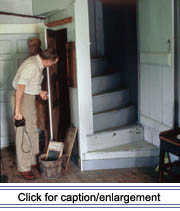 Historic architecture specialist Howard Marshall examines an interior detail of the Fred Albert house in Madawaska during fieldwork during fieldwork in 1991.