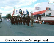 A color gaurd participates in the 1991 Acadian Festival annual parade. The solitary soldier in camoflage represents the troops serving in Operation Desert Storm.