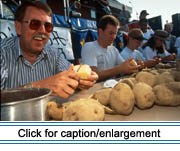 Saint John Valley Times editor Don Levesque competes at the potato-peeling contest at the 1995 Acadian Festival in Madawaska.