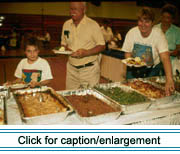 Pot-en-pot, fougére and baked beans are just a few of the local delicacies served to participants at the 1995 Chassé Family Reunion in Madawaska.