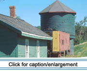 "This 50,000-gallon water tank and railroad station house built in 1910 by the Bangor and Aroostook Railroad, and the Pullman company ""Troop Sleeper Car"" built in 1943 form the core of the Frenchville Historical Society. Both structures are listed in the National Register of Historic Places."