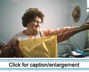 Mrs. Fabienne Landry of Edmundston, New Brunswick ripping guenilles (rag strips) for the weft of a catalogne (woven blanket with a cotton warp and salvaged cotton weft) from salvaged cotton fabric.