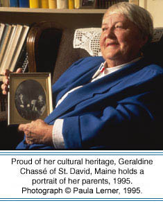 Proud of her cultural heritage, Geraldine Chassé of St. David, Maine holds a portrait of her parents, 1995. Photographer: Paula Lerner,   2003.