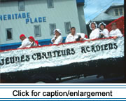 Les jeunes chauteurs acadiens, a French-language singing group from Dr. Levesque Elementary School in Frenchville, Maine, sing out at the Acadian Festival parade in Madawaska, 1995.